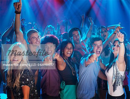 Portrait of enthusiastic crowd on dance floor of nightclub Stock Photo - Premium Royalty-Free, Image code: 6113-06498637