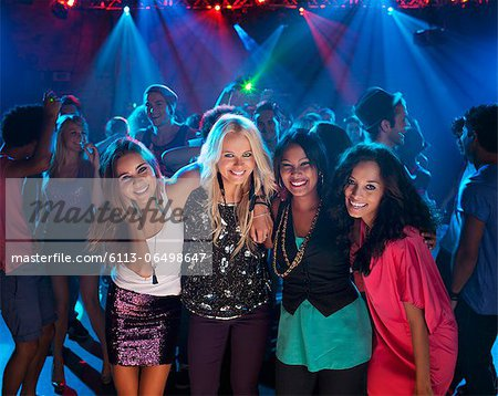 Portrait of smiling women on dance floor at nightclub Stock Photo - Premium Royalty-Free, Image code: 6113-06498647