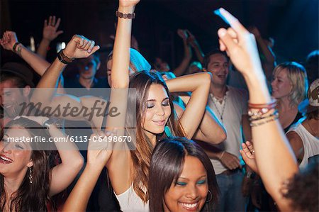 Crowd dancing on dance floor of nightclub Stock Photo - Premium Royalty-Free, Image code: 6113-06498670