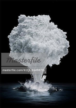Smoke forming mushroom cloud Stock Photo - Premium Royalty-Free, Image code: 6113-06498716