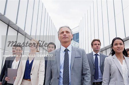Confident business people looking ahead Stock Photo - Premium Royalty-Free, Image code: 6113-06498777