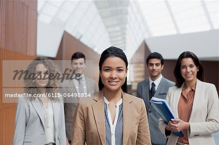 Portrait of confident business people Stock Photo - Premium Royalty-Free, Image code: 6113-06498834