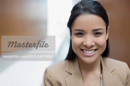 Close up portrait of confident businesswoman Stock Photo - Premium Royalty-Free, Image code: 6113-06498857