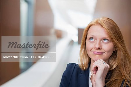 Portrait of pensive businesswoman looking up Stock Photo - Premium Royalty-Free, Image code: 6113-06498888