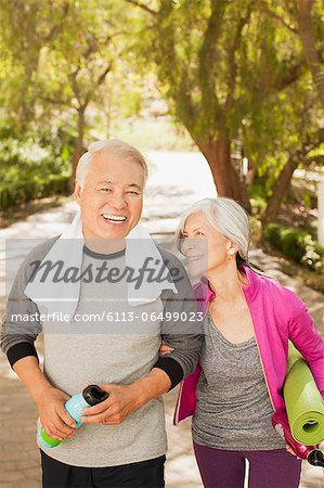 Older couple walking together outdoors Stock Photo - Premium Royalty-Free, Image code: 6113-06499023