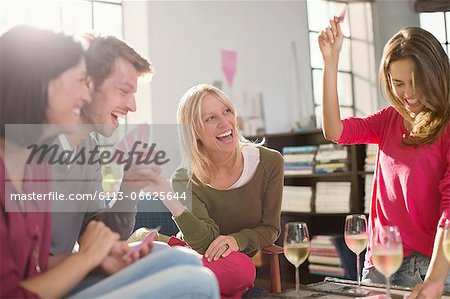Friends playing card games in living room Stock Photo - Premium Royalty-Free, Image code: 6113-06625644