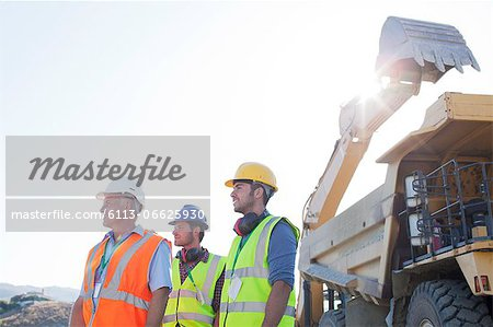 Workers standing on site Stock Photo - Premium Royalty-Free, Image code: 6113-06625930