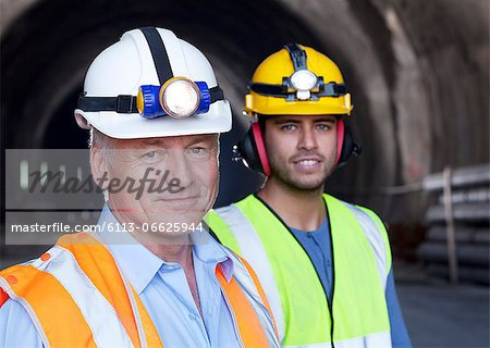 Businessman and worker smiling together Stock Photo - Premium Royalty-Free, Image code: 6113-06625944