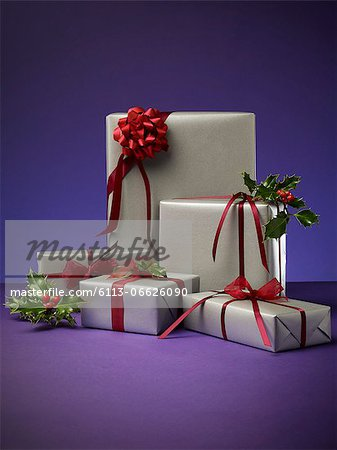Stack of wrapped Christmas presents Stock Photo - Premium Royalty-Free, Image code: 6113-06626090
