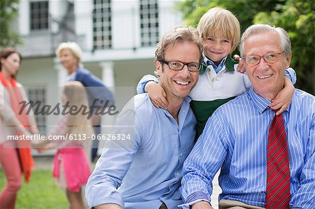 Three generations of men smiling together Stock Photo - Premium Royalty-Free, Image code: 6113-06626324