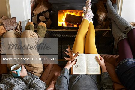 Children relaxing by fire Stock Photo - Premium Royalty-Free, Image code: 6113-06720300