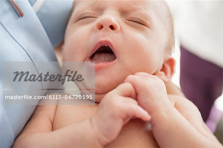 Close up of newborn baby yawning Stock Photo - Premium Royalty-Free, Image code: 6113-06720595