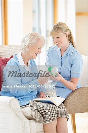 Caregiver talking with older woman Stock Photo - Premium Royalty-Free, Image code: 6113-06720632