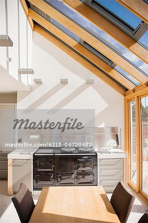 Stove and table in modern kitchen Stock Photo - Premium Royalty-Free, Image code: 6113-06720672