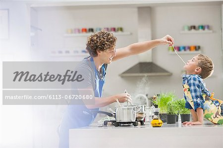 Father and son cooking in kitchen Stock Photo - Premium Royalty-Free, Image code: 6113-06720680