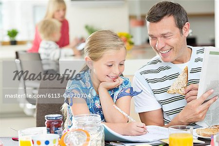 Father and daughter having breakfast Stock Photo - Premium Royalty-Free, Image code: 6113-06720704