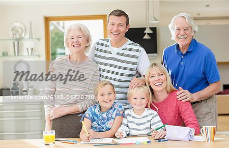 Family smiling together in kitchen Stock Photo - Premium Royalty-Free, Image code: 6113-06720718