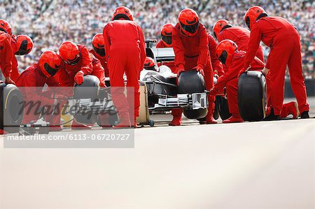 Race car team working at pit stop Stock Photo - Premium Royalty-Free, Image code: 6113-06720727
