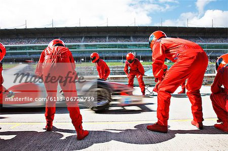 Racing team working at pit stop Stock Photo - Premium Royalty-Free, Image code: 6113-06720739