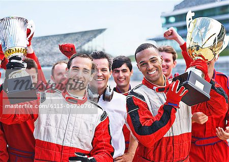 Racers and team cheering on track Stock Photo - Premium Royalty-Free, Image code: 6113-06720761