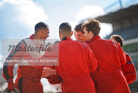 Racer and team talking on track Stock Photo - Premium Royalty-Free, Image code: 6113-06720765