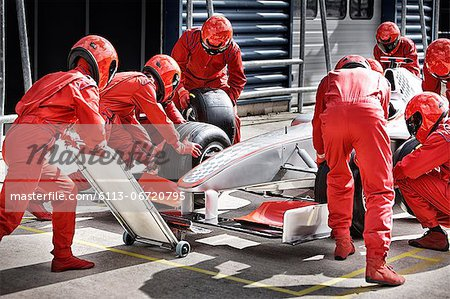 Racing team working at pit stop Stock Photo - Premium Royalty-Free, Image code: 6113-06720795