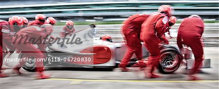 Racing team working at pit stop Stock Photo - Premium Royalty-Free, Image code: 6113-06720830