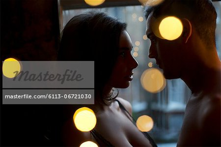 Couple looking into each other's eyes Stock Photo - Premium Royalty-Free, Image code: 6113-06721030