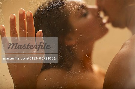Nude couple kissing in shower Stock Photo - Premium Royalty-Free, Image code: 6113-06721051