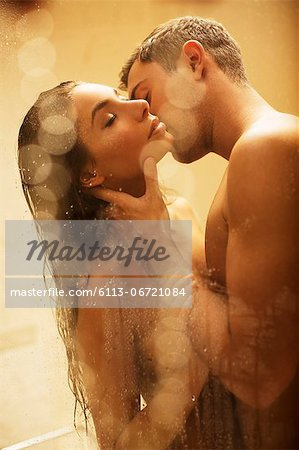 Nude couple kissing in shower Stock Photo - Premium Royalty-Free, Image code: 6113-06721084