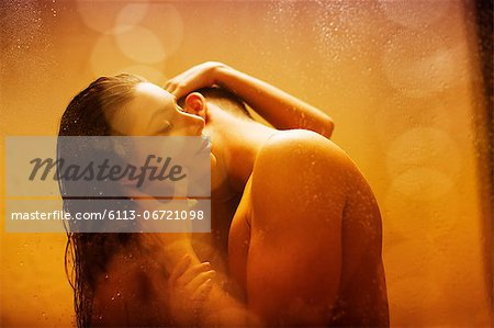 Nude couple kissing in shower Stock Photo - Premium Royalty-Free, Image code: 6113-06721098