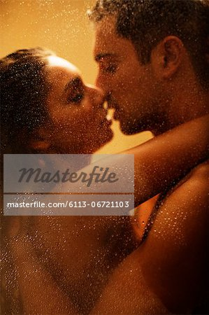 Nude couple kissing in shower Stock Photo - Premium Royalty-Free, Image code: 6113-06721103