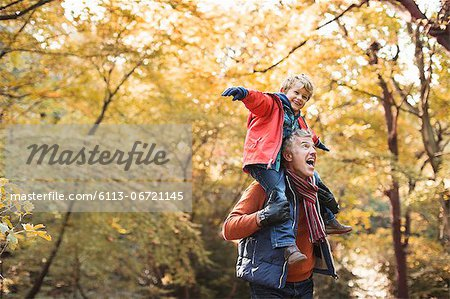 Older man carrying grandson on shoulders Stock Photo - Premium Royalty-Free, Image code: 6113-06721145