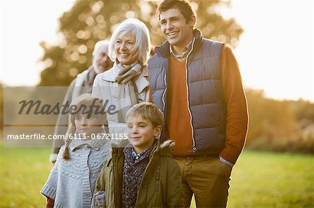 Family walking together in park Stock Photo - Premium Royalty-Free, Image code: 6113-06721155