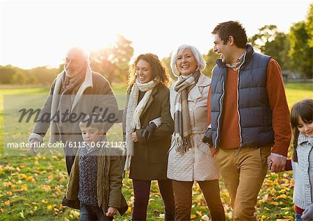 Family walking together in park Stock Photo - Premium Royalty-Free, Image code: 6113-06721172