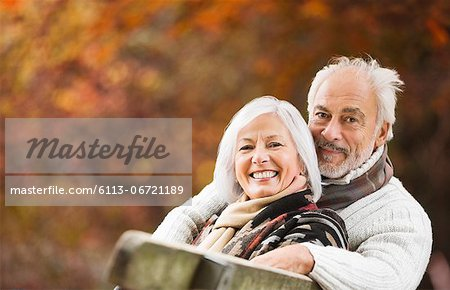 Older couple sitting on park bench Stock Photo - Premium Royalty-Free, Image code: 6113-06721189