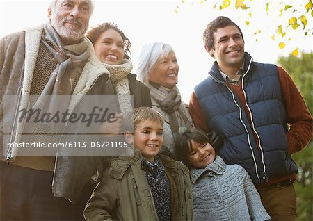 Family smiling together in park Stock Photo - Premium Royalty-Free, Image code: 6113-06721195