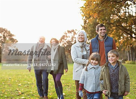 Family walking together in park Stock Photo - Premium Royalty-Free, Image code: 6113-06721242