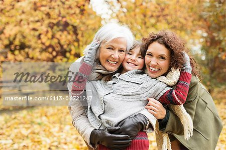 Three generations of women smiling in park