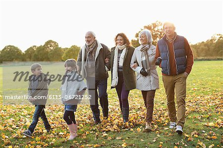 Family walking together in park Stock Photo - Premium Royalty-Free, Image code: 6113-06721252