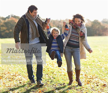 Family walking together in park Stock Photo - Premium Royalty-Free, Image code: 6113-06721265