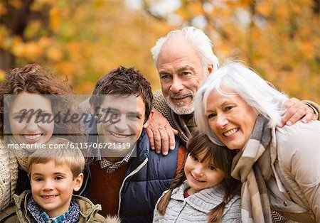 Family smiling together in park Stock Photo - Premium Royalty-Free, Image code: 6113-06721319