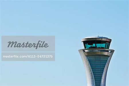 Air traffic control tower and blue sky Stock Photo - Premium Royalty-Free, Image code: 6113-06721375