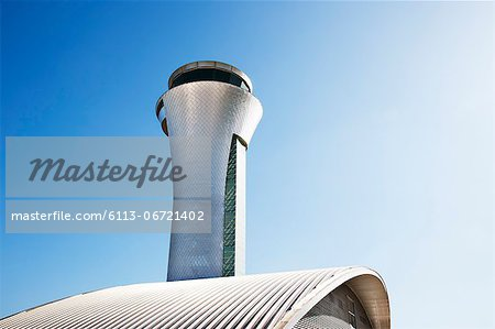 Air traffic control tower and blue sky Stock Photo - Premium Royalty-Free, Image code: 6113-06721402