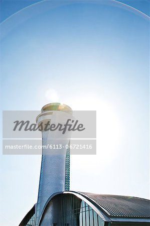 Air traffic control tower and blue sky Stock Photo - Premium Royalty-Free, Image code: 6113-06721416