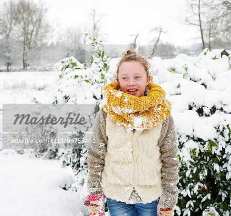 Girl smiling in snow Stock Photo - Premium Royalty-Free, Image code: 6113-06753401