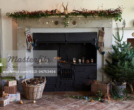 Fireplace decorated for Christmas Stock Photo - Premium Royalty-Free, Image code: 6113-06753406