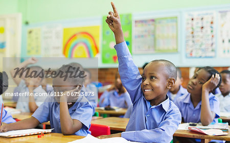 Student raising hand in class Stock Photo - Premium Royalty-Free, Image code: 6113-06753873