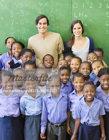 Students and teachers smiling in class Stock Photo - Premium Royalty-Free, Image code: 6113-06753877