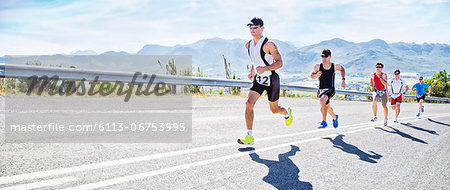 Runners in race on rural road Stock Photo - Premium Royalty-Free, Image code: 6113-06753995